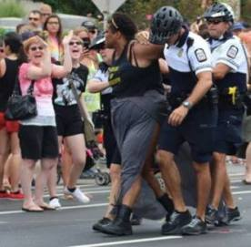 June 17th, 2017 – A group of Black queer and trans protesters and their allies gathered with the intent of silently blocking the parade for seven minutes to hold space for Black and brown queer and trans people. Instead of allowing the Columbus Pride protesters to exericese their First Amendment right undisturbed Columbus Police Department (CPD) officers promptly rammed protesters with bikes, maced them, shoved them to the ground, chased them with horses, etc. This all took place within the first two minutes of protesters blocking the street.